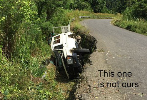 Dangers of driving on PNG roads (not our car though)