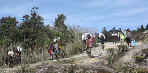 Porters with cargo on their way between two camps