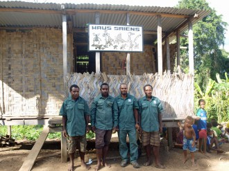 Wanang team of biological experts (L to R): Dominic Rinan (plants), Jonah Filip (insects), Byron Siki (plants), Mark Mulau (birds) in front of Haus Saiens.