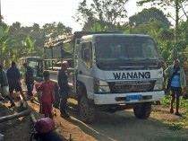 Village truck serving as a connection with Madang town, its markets and shops.