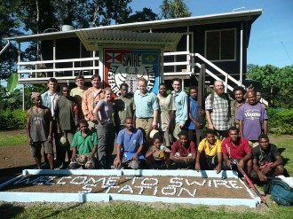 Swire Station visited by Merlin Swire with the community leader Filip Damen (centre), together with Wanang villagers, Binatang Center staff and visiting researchers