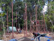 Construction site in the rainforest - erecting the first building.